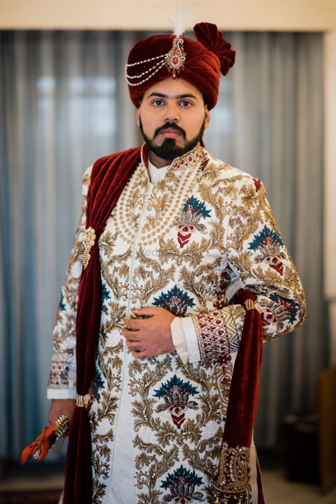 Photo of Ivory embroidered sherwani with a pop of blue