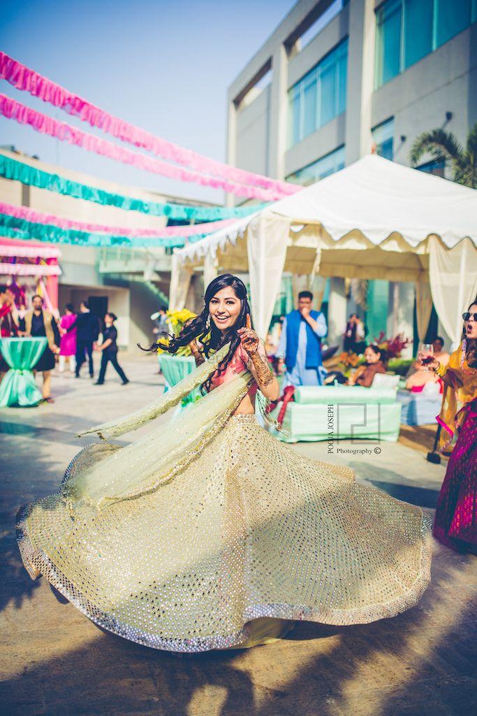 Photo of Mehendi twirling bride shot