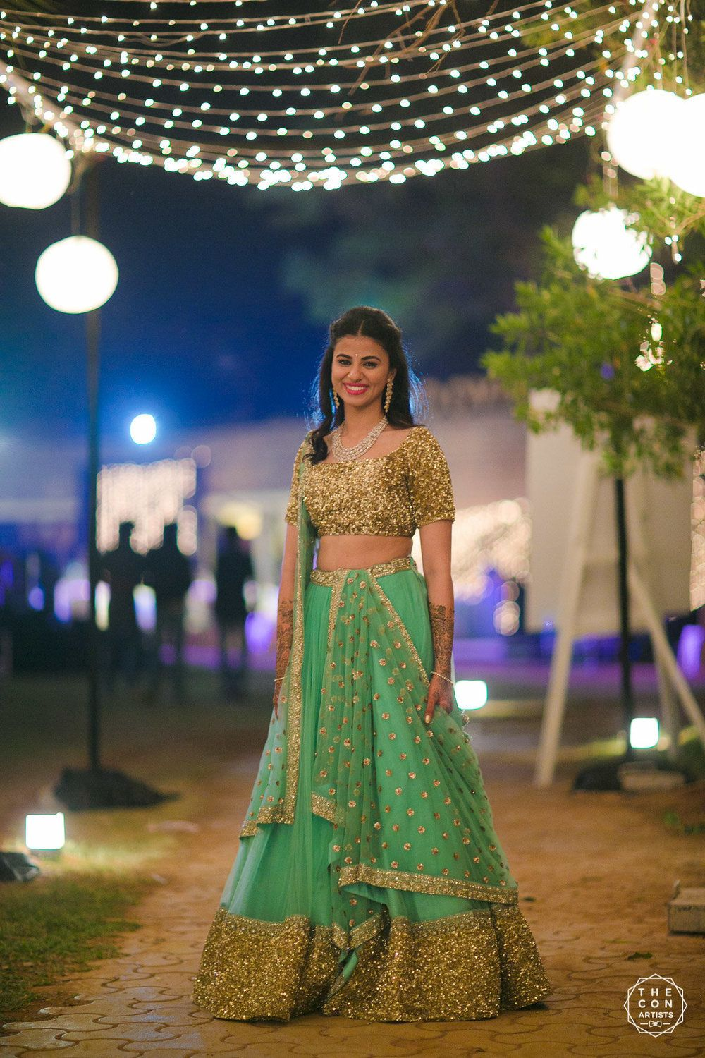 Photo of Gold and green sparkly lehenga