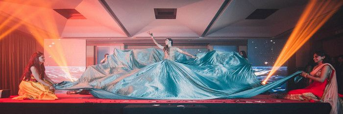 Photo of Sangeet Idea- large skirt prop for the bride