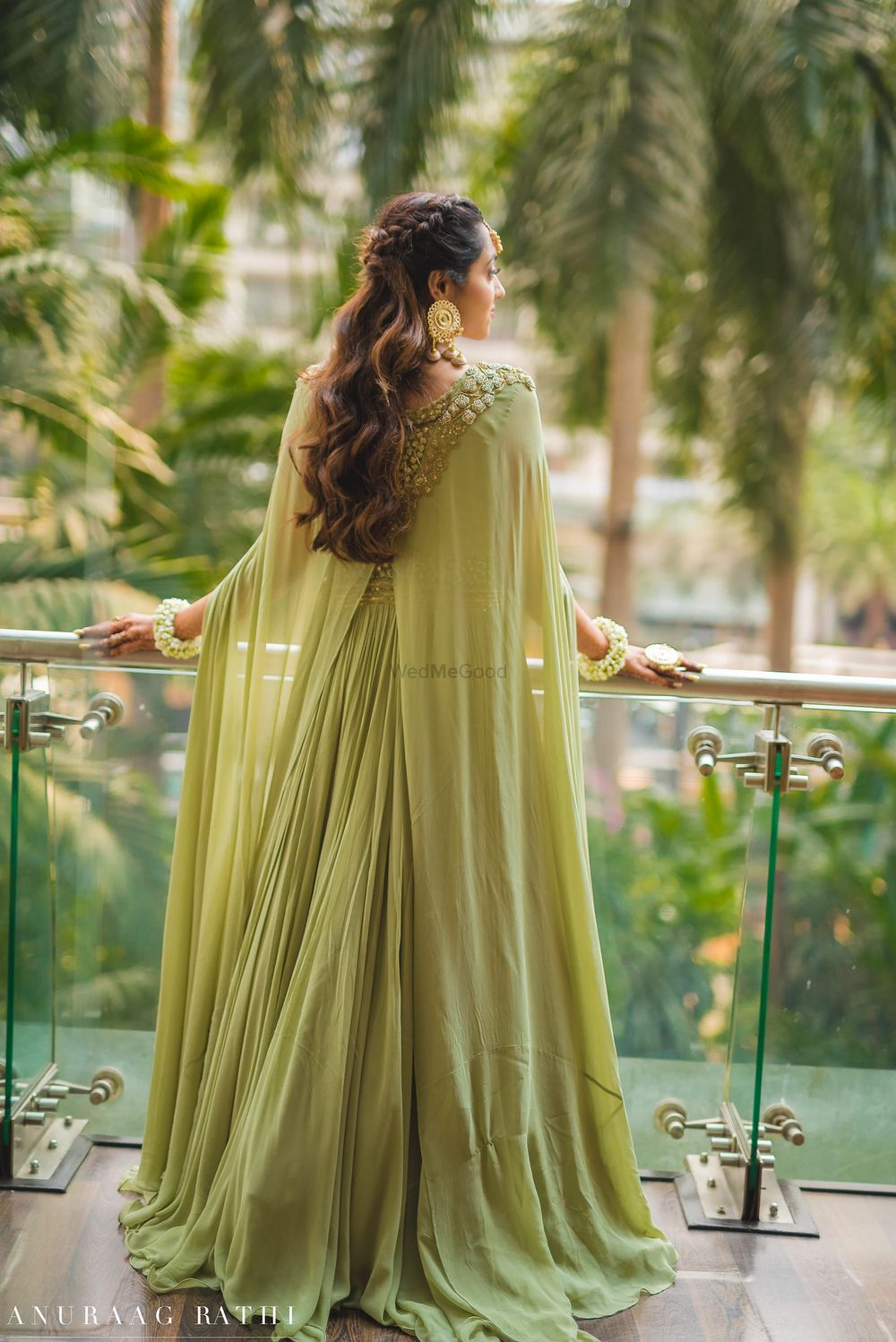 Photo of Sage green cape lehenga with embroidered shoulder