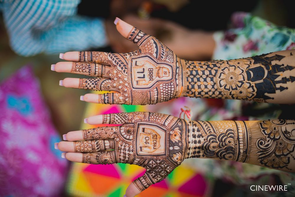 Photo of Personalised bridal mehendi with jerseys