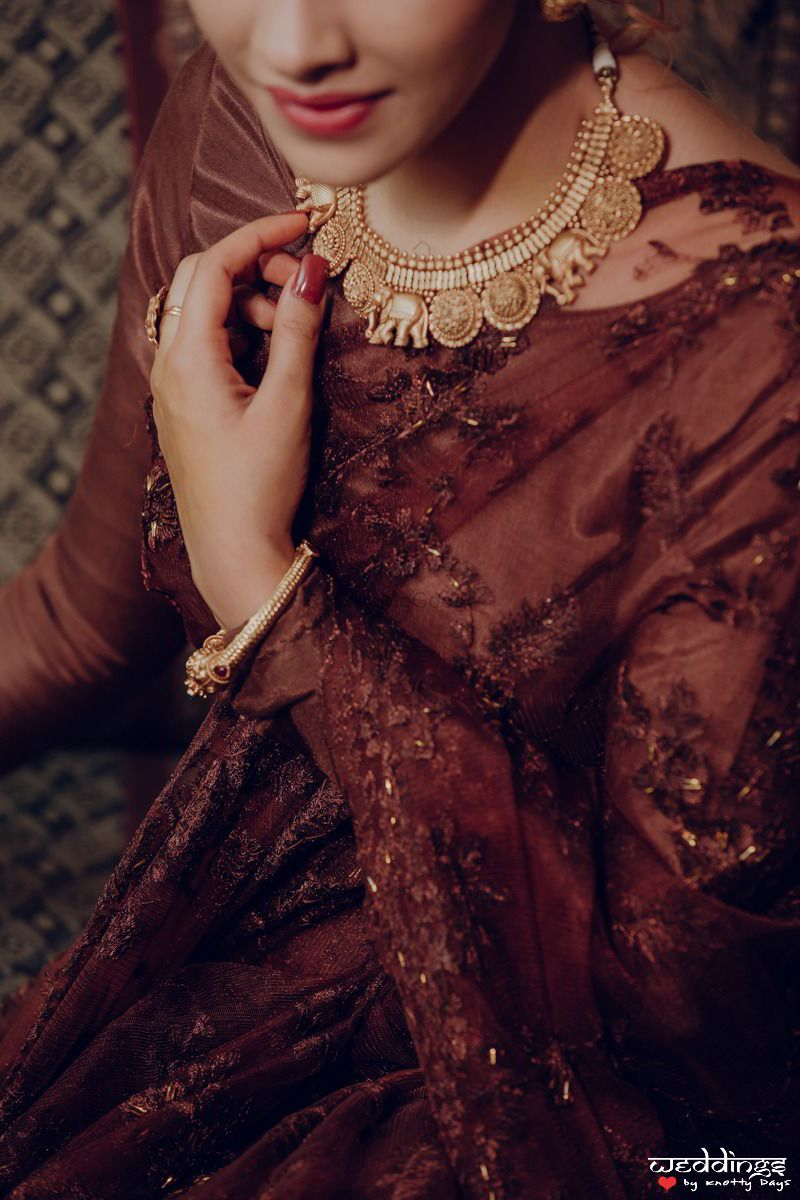 Photo of Lace saree for cocktail with gold necklace and jewellery