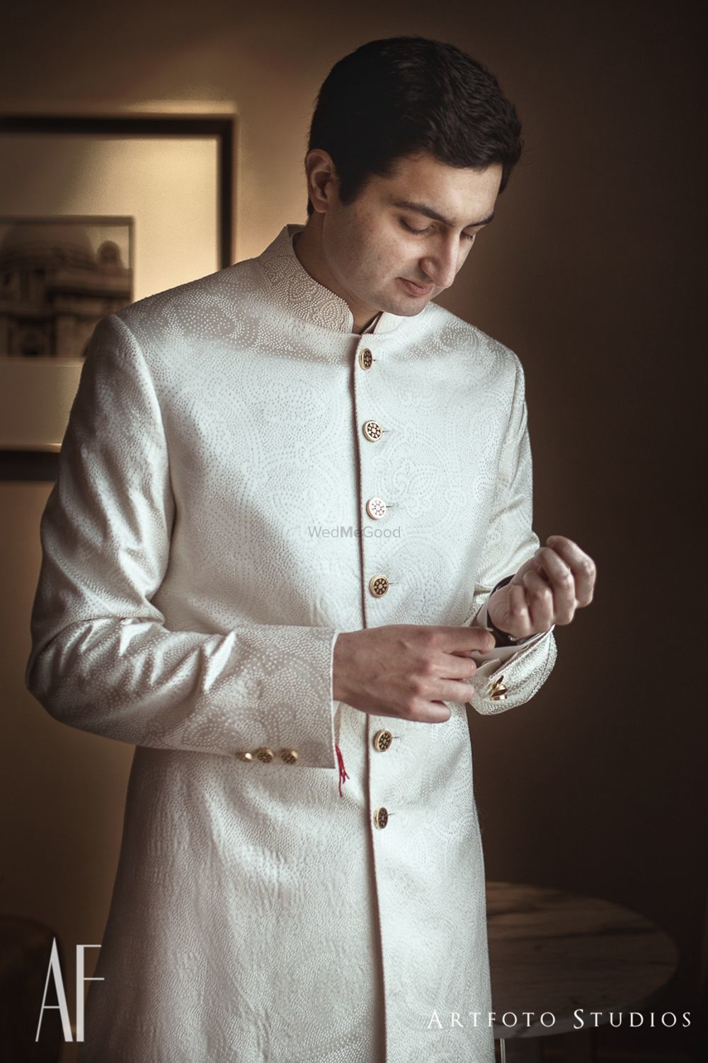 Photo of Off white sherwani with gold buttons