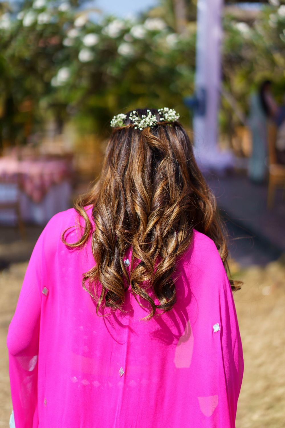 Photo of open hair with floral crown hairstyle for the mehendi