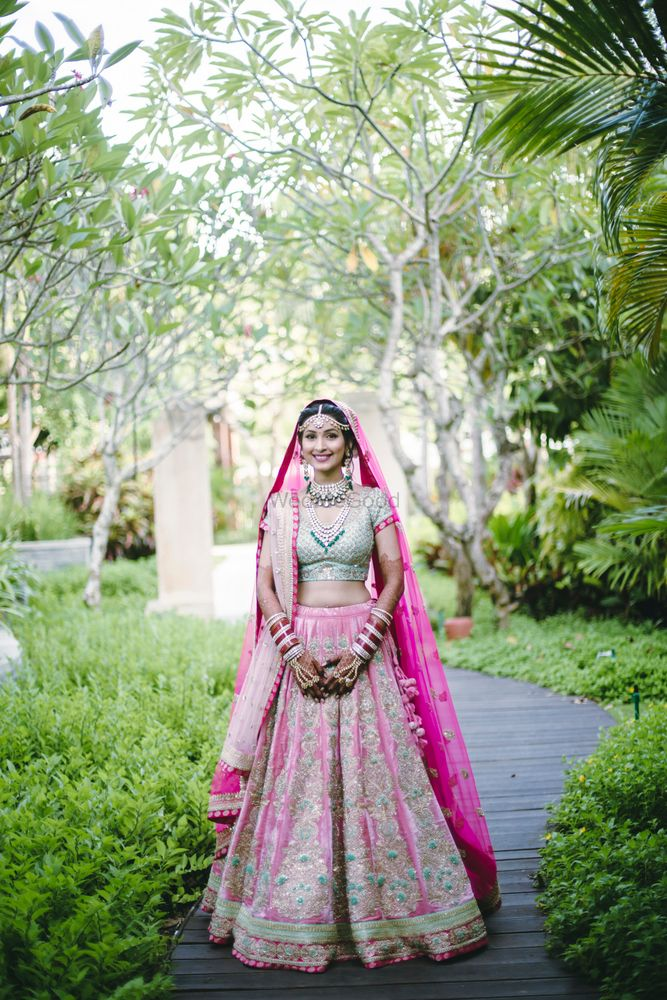 Photo of Mint green and pink bridal lehenga