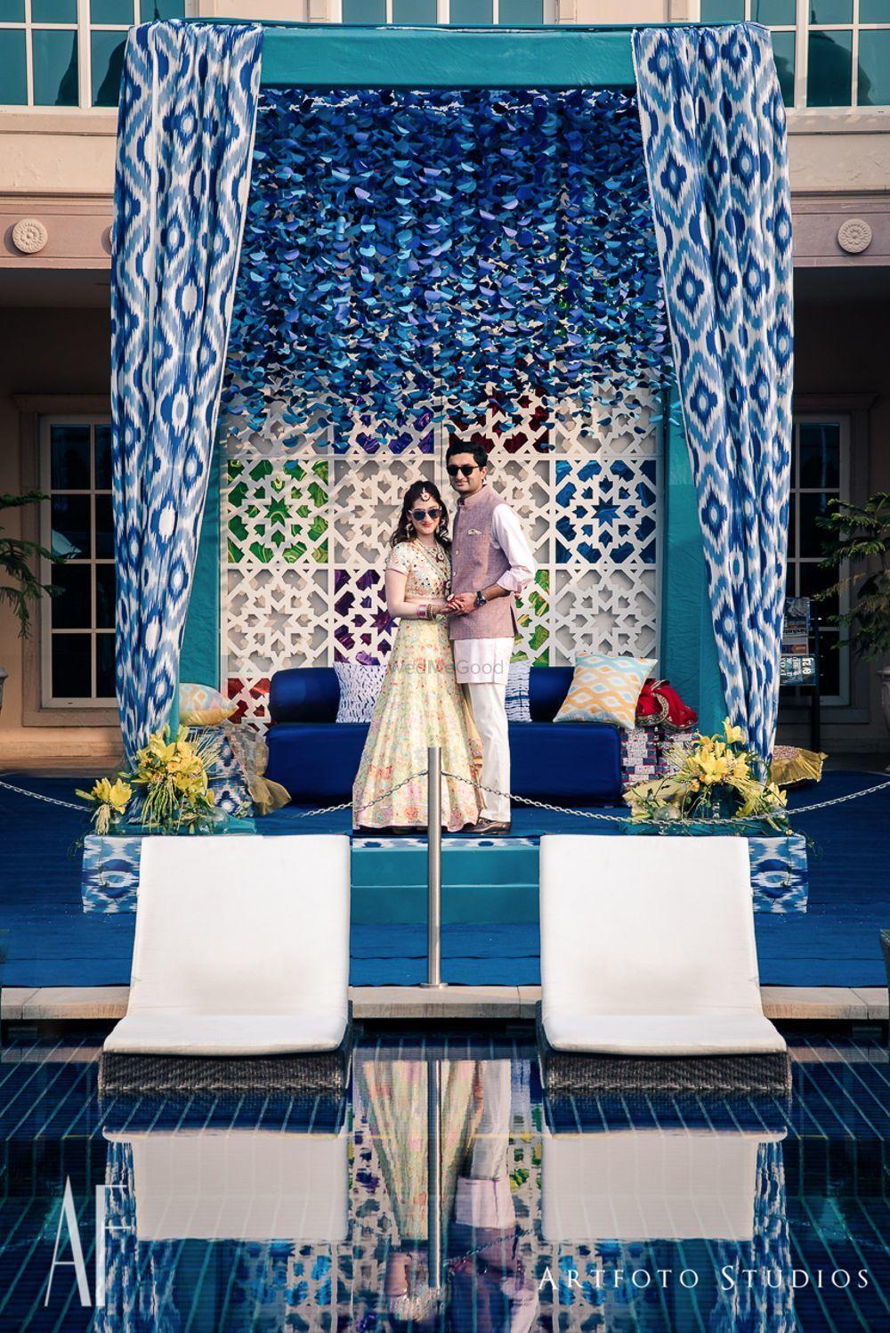 Photo of Unique drape ikat mandap with blue theme