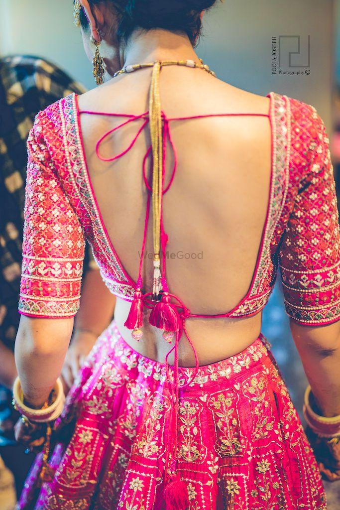 Photo of Deep bridal blouse back design