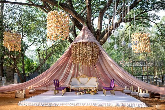 Photo of Gorgeous floral mandap with hanging strings