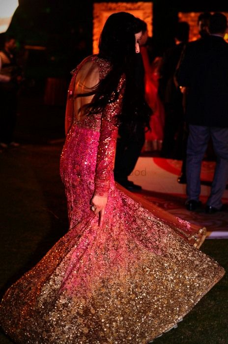 Photo of Pink and Gold Glitter Twirling Anarkali