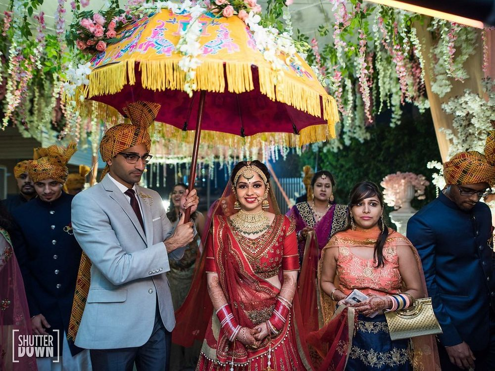 Photo of Unique bridal entry idea under umbrella