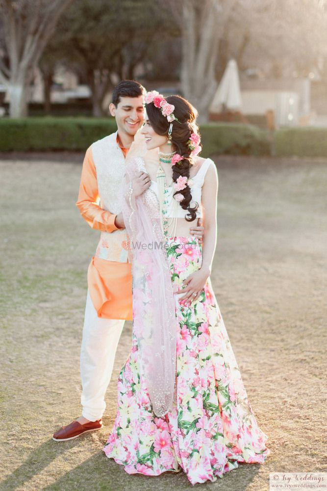 Photo of Floral print mehendi lehenga with floral hairstyle