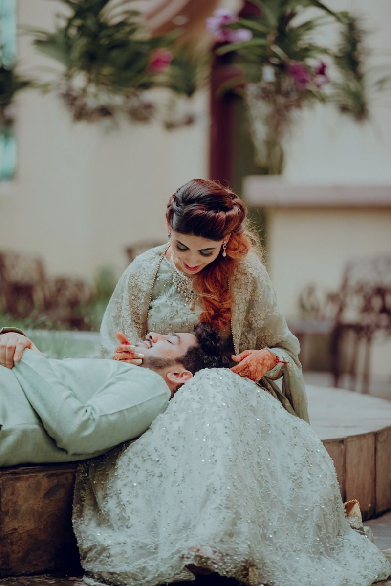 Photo of Cute couple portrait idea with groom on brides lap