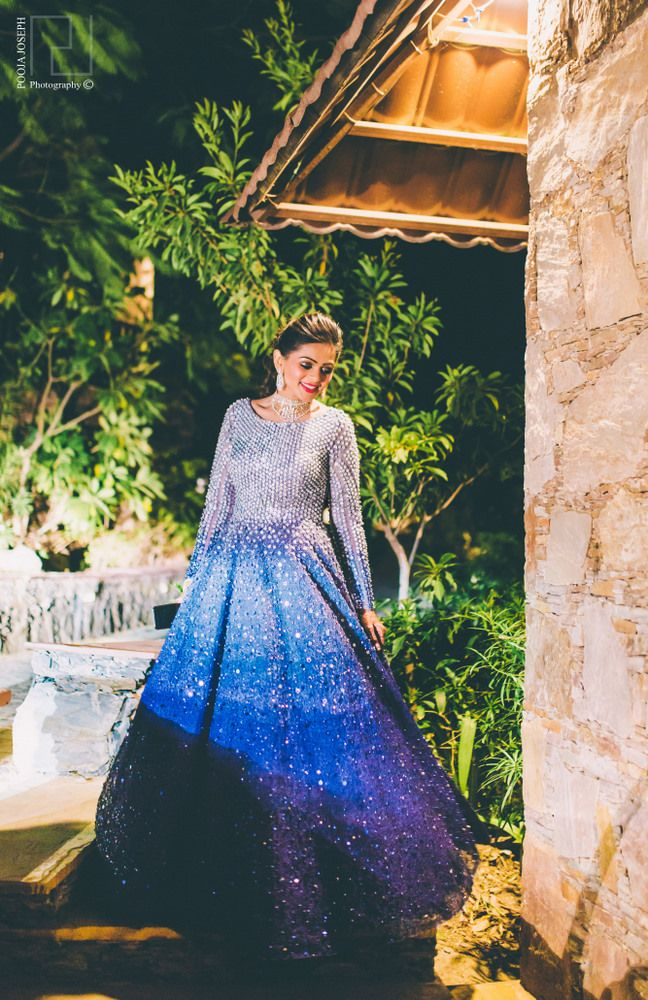 Photo of Silver and navy blue sequin sangeet outfit