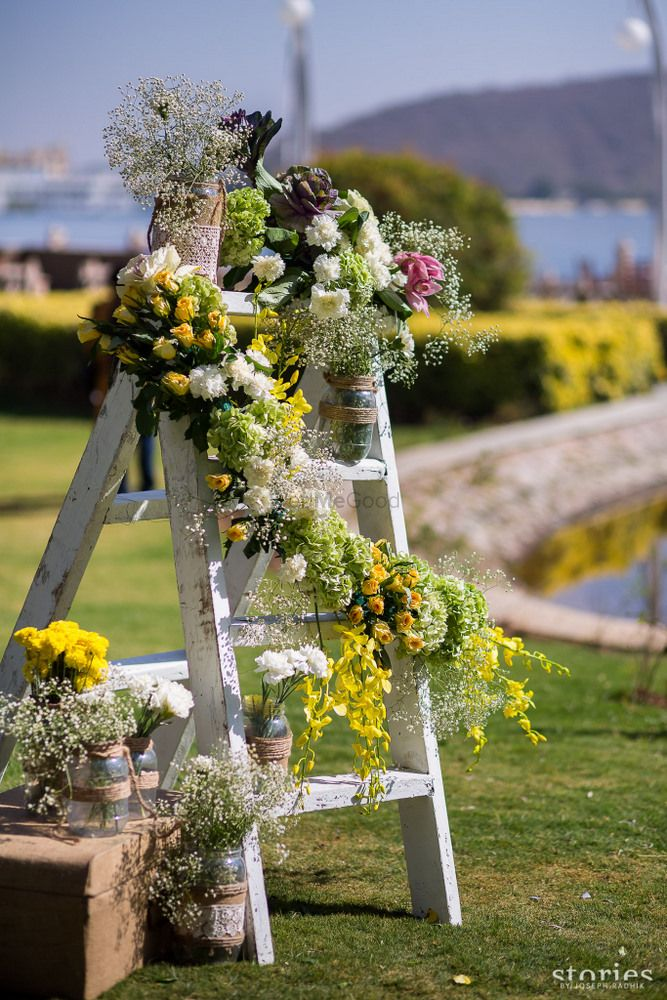 Photo of Wooden ladder with floral arrangements