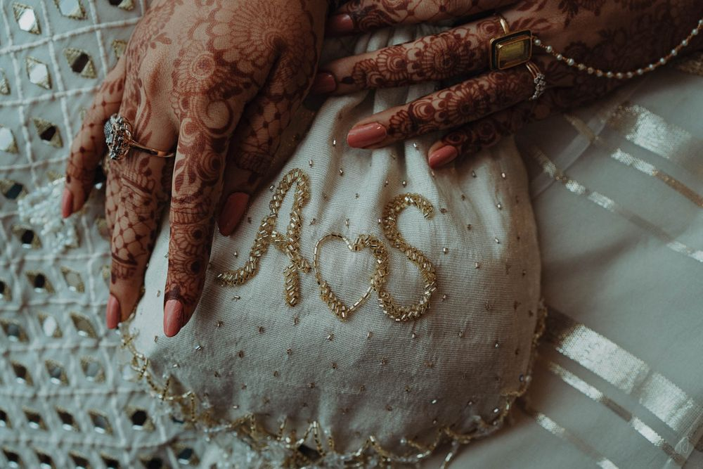 Photo of Personalised bridal potli with bride and groom initials