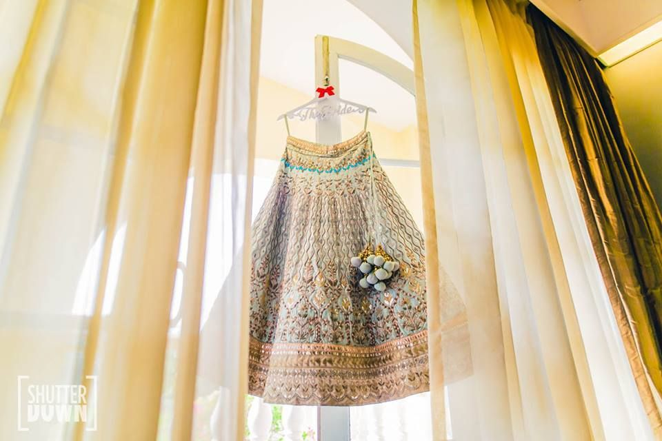 Photo of Unique lehenga on hanger in peach and mint