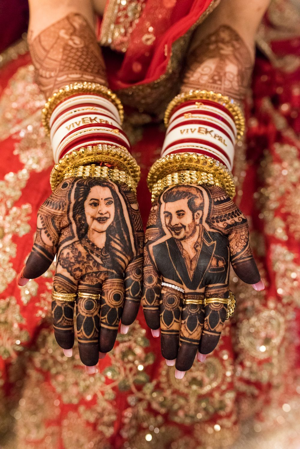 Photo of Bridal mehendi with portrait with customised Chura
