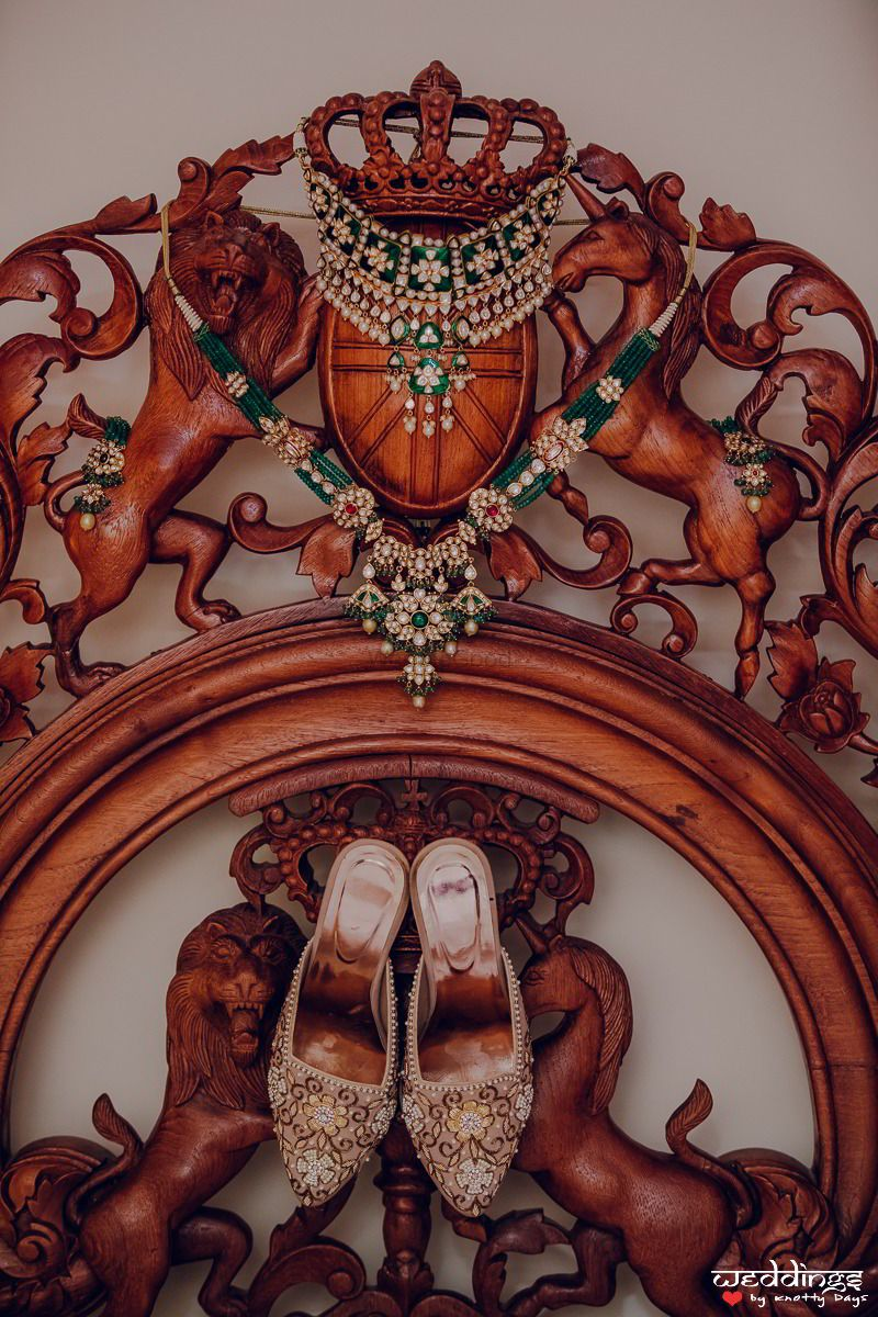 Photo of Jewellery with green beads and bridal shoes getting ready shot