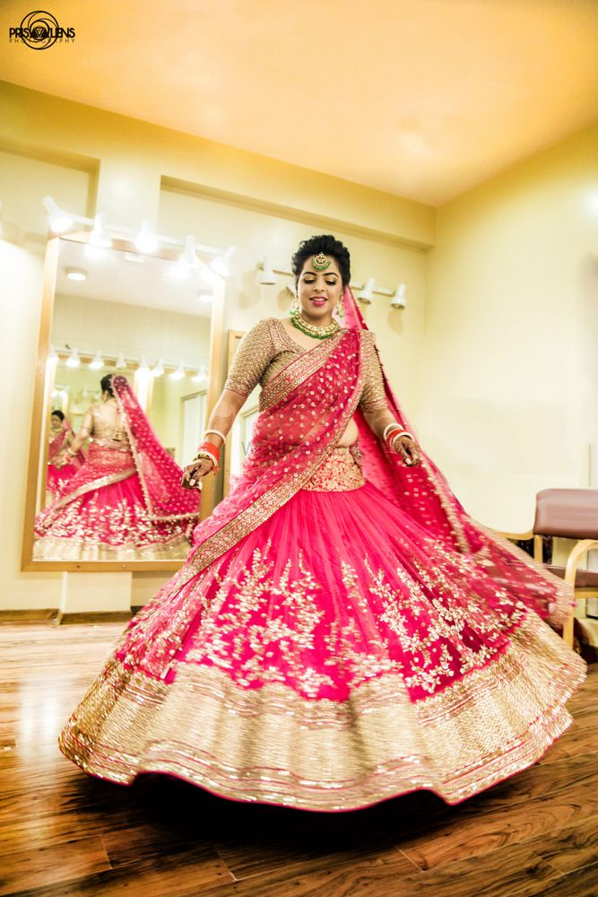 Photo of twirling bride