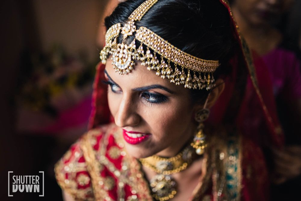 Photo of Statement bridal mathapatti with thick stands