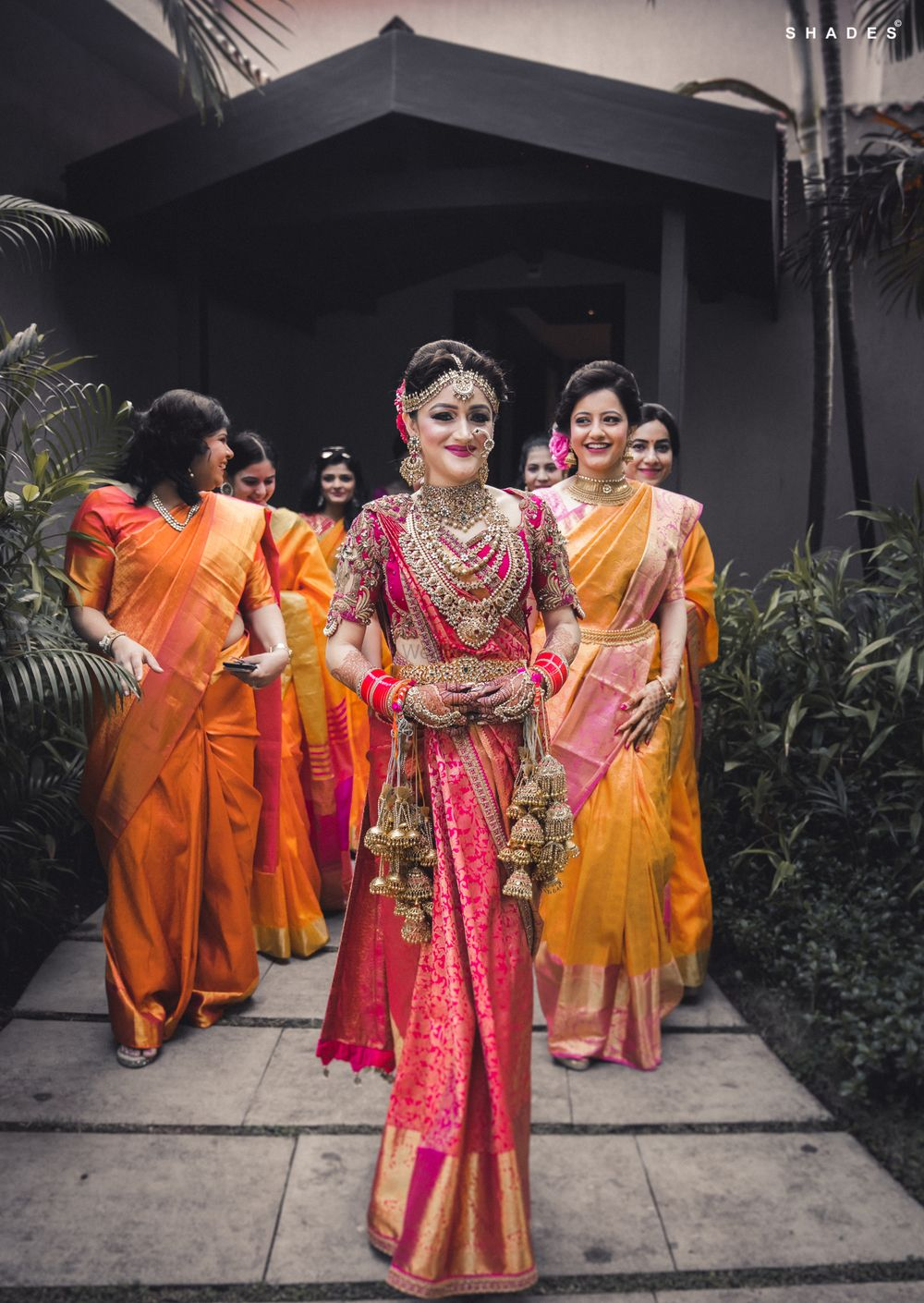 Photo of A north-sound Indian bride in Kanjeevaram saree and kaleere