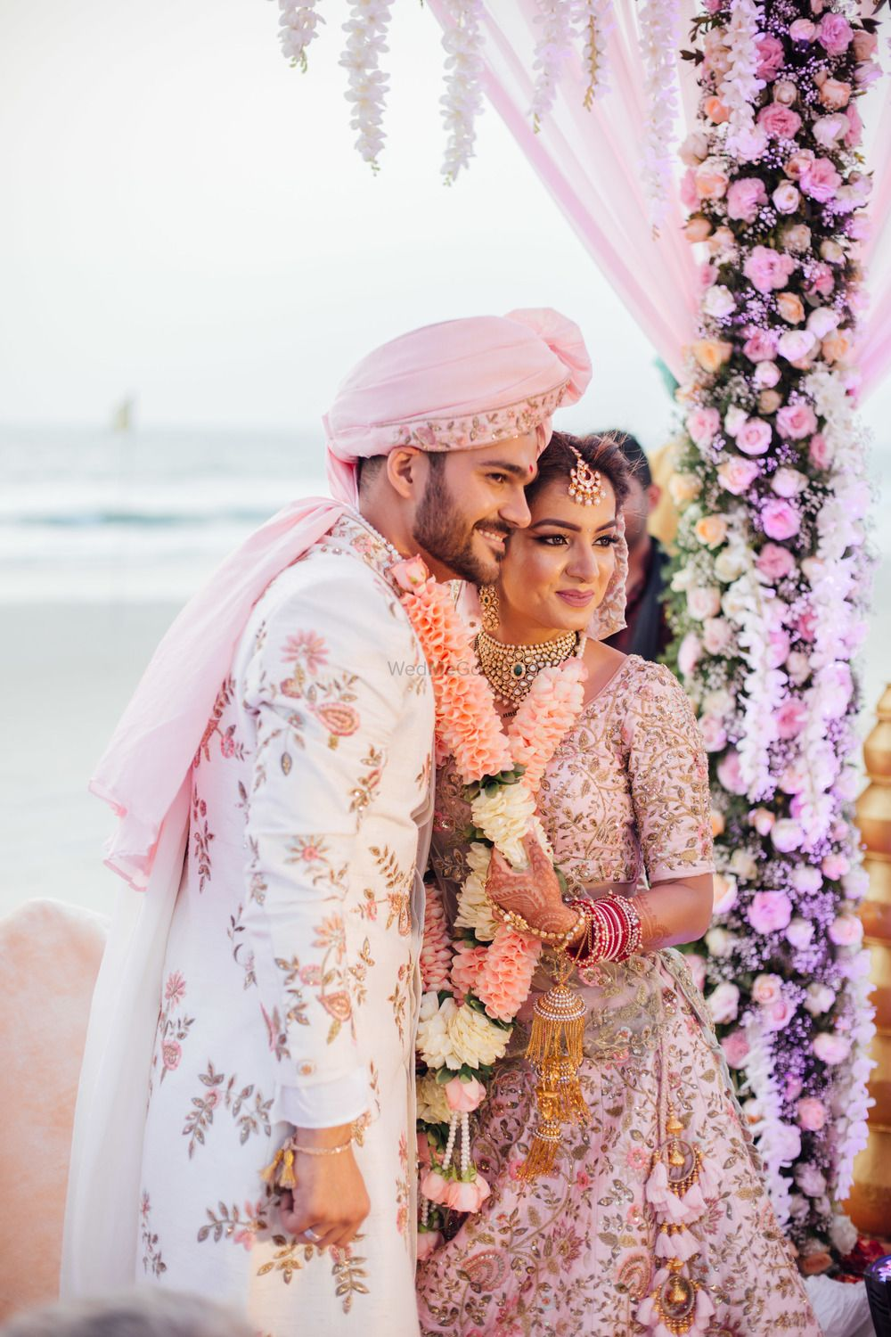 Photo of White and pink floral sherwani for groom