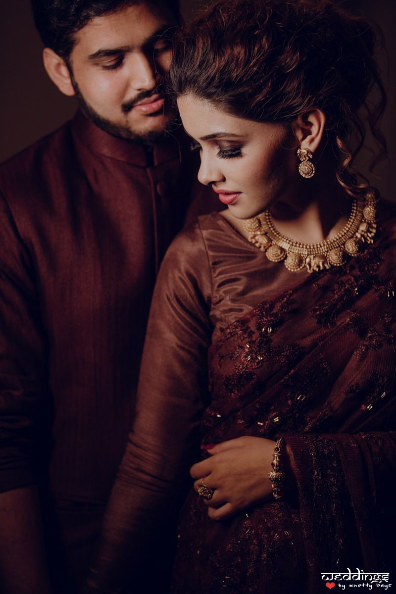 Photo of Engagement or sangeet couple portrait in brown