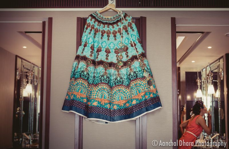 Photo of Teal and turquoise lehenga for sangeet on hanger