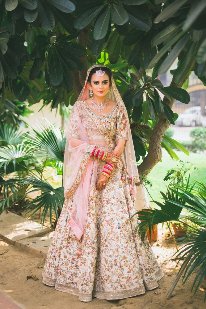 Photo of Floral embroidery cream and pink lehenga