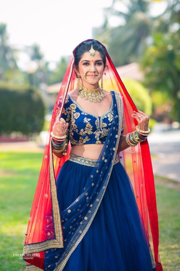 Photo of Sabyasachi bridal lehenga with contrasting dupatta