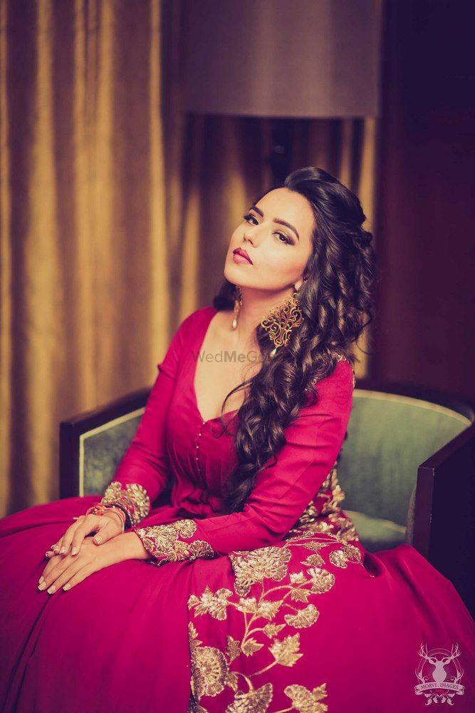Photo of Manish malhotra wine colored gown