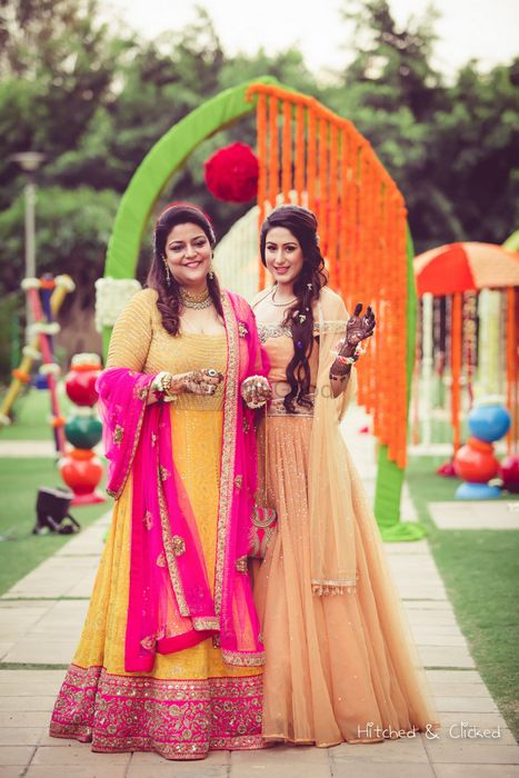 Photo of Bride and her mother at mehendi