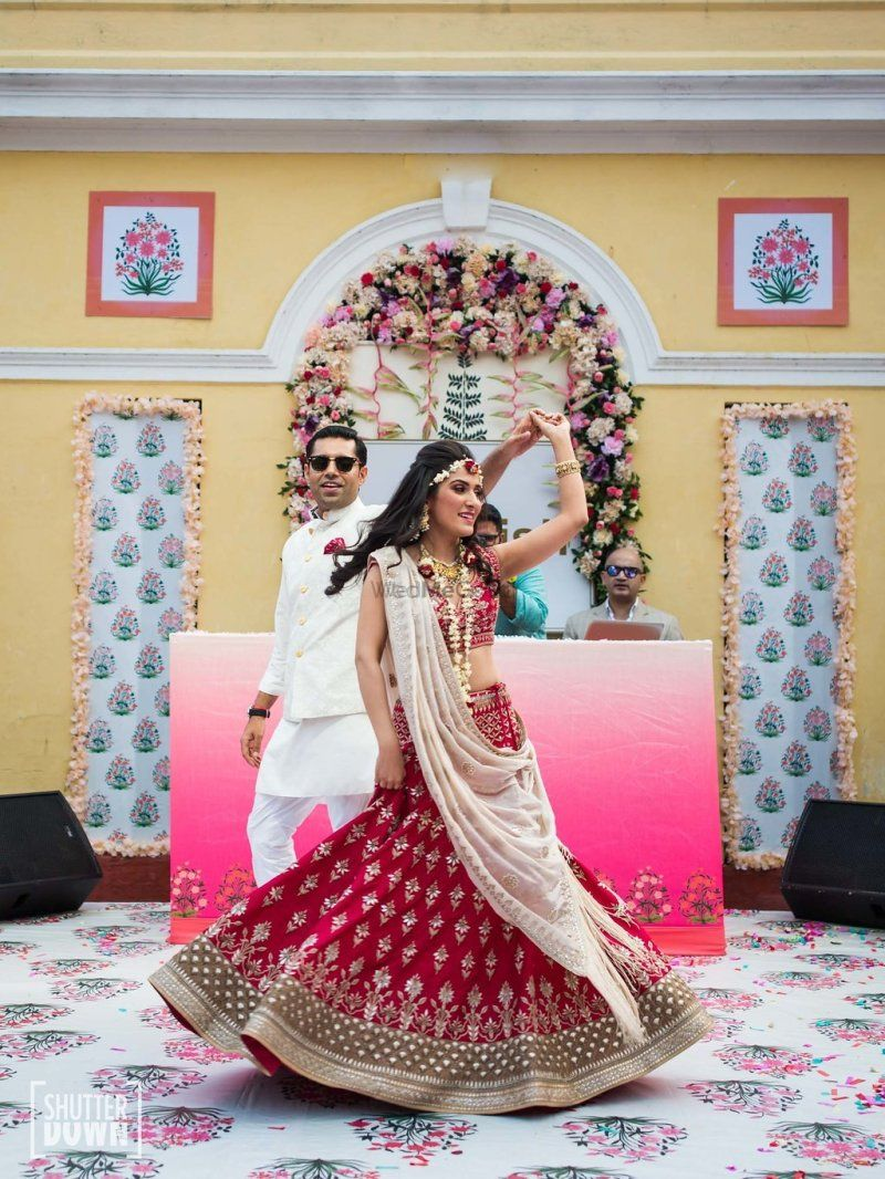 Photo of Bride and groom dancing on printed dance floor