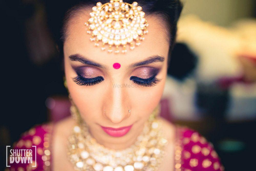 Photo of purple smokey eyes bridal makeup