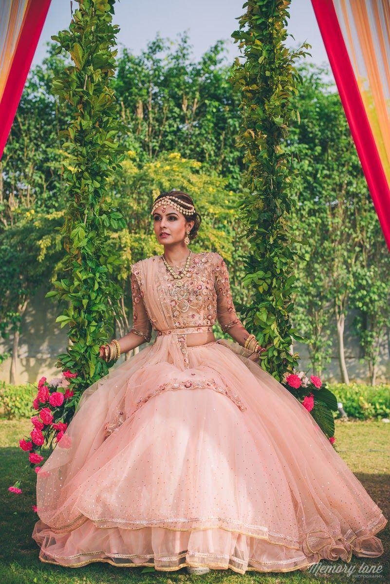 Photo of Light pink lehenga on engagement
