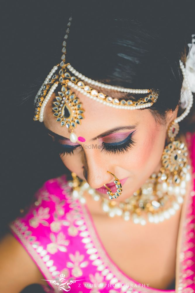 Photo of Pink smokey eye with bright pink lehenga