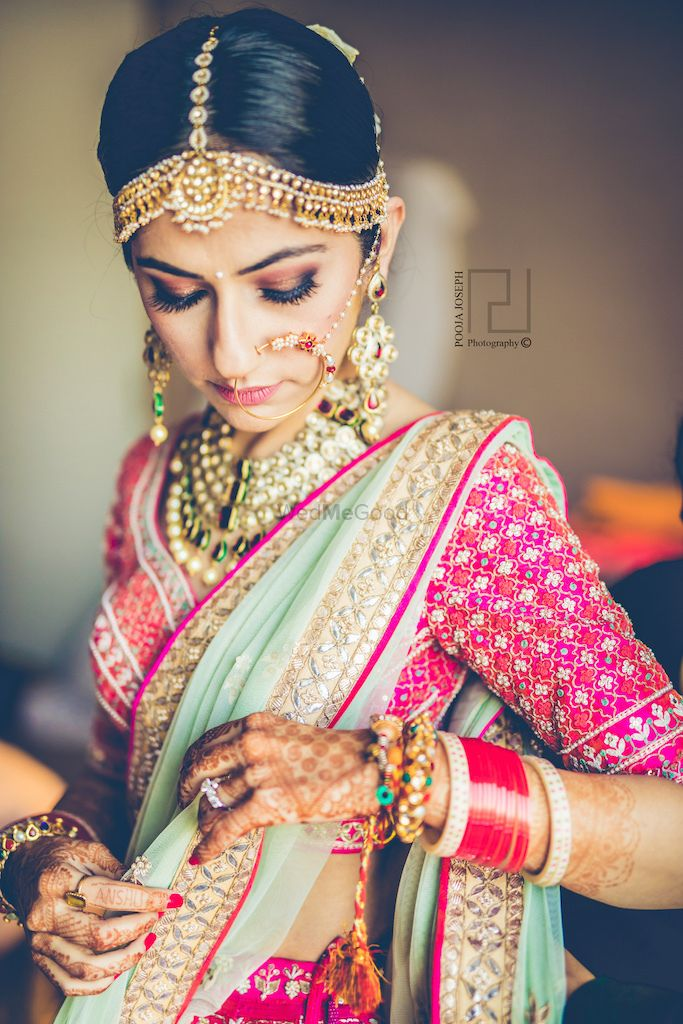 Photo of Bride getting ready in pink and mint lehenga