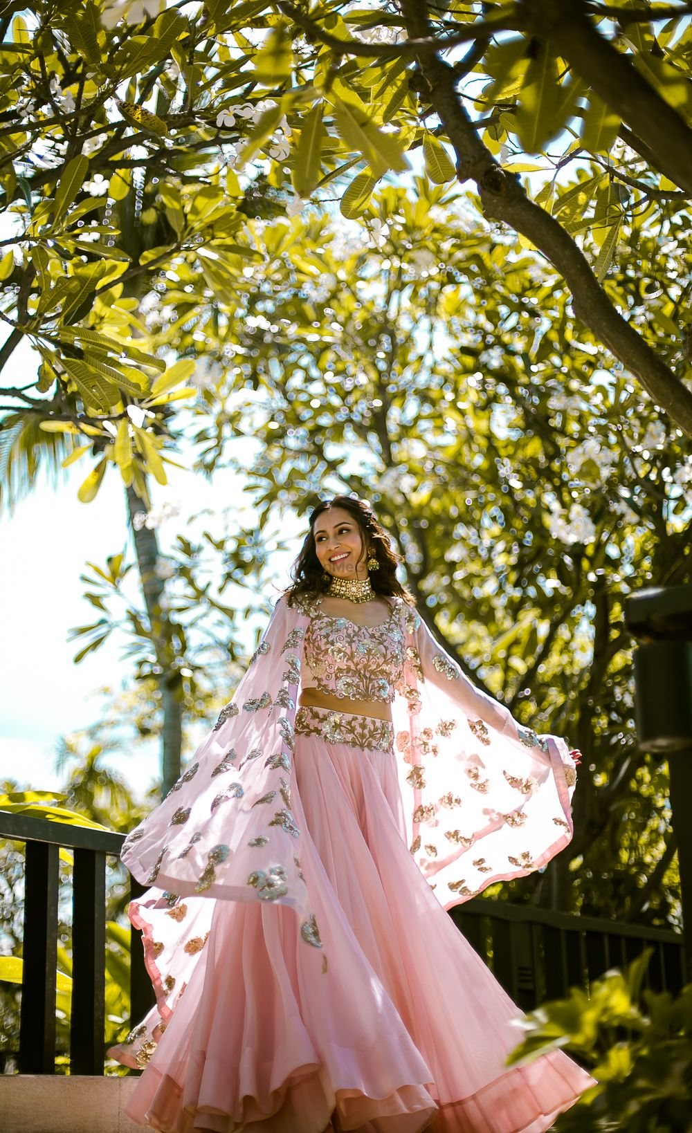 Photo of Light pink Indo western mehendi outfit with cape jacket