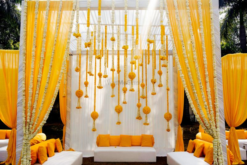 Photo of Mehendi yellow mandap seating idea