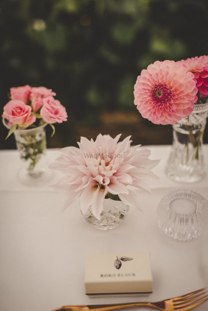 Photo of Table settings with crystal and pink at Indian wedding
