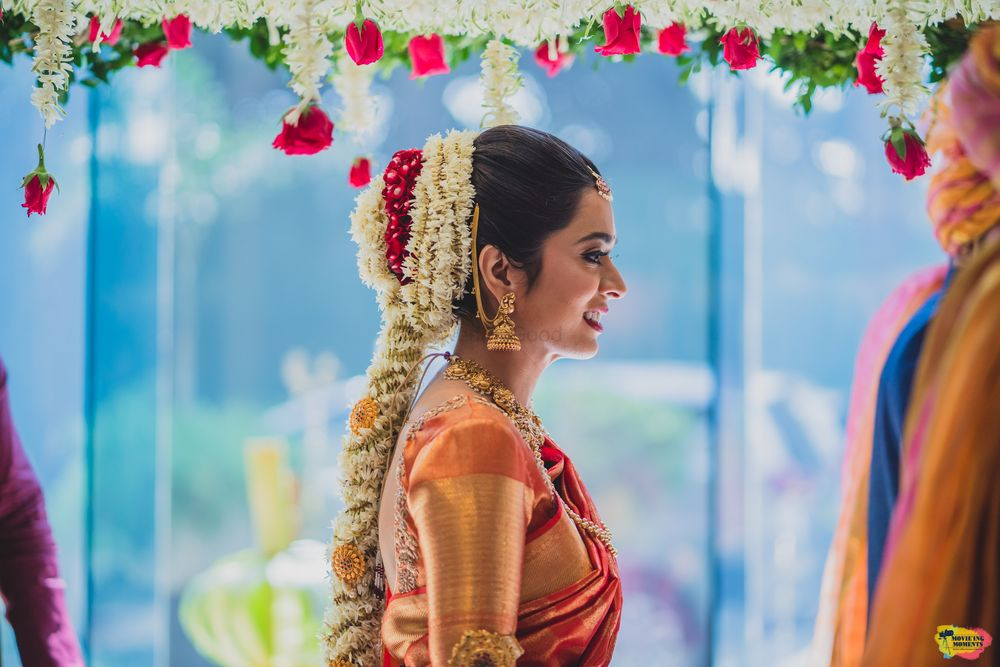 Photo of South indian bridal hairstyle with floral jada