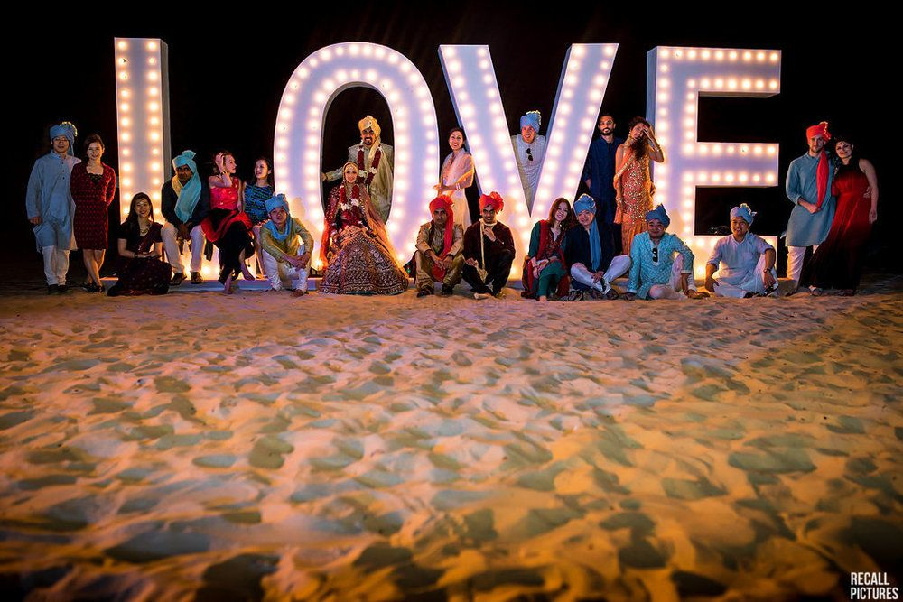 Photo of Giant love prop for beach wedding