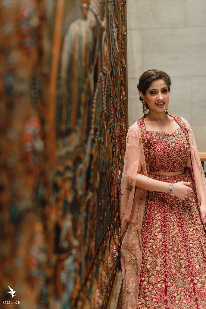 Photo of A bride to be in a shimmer lehenga for her engagement ceremony