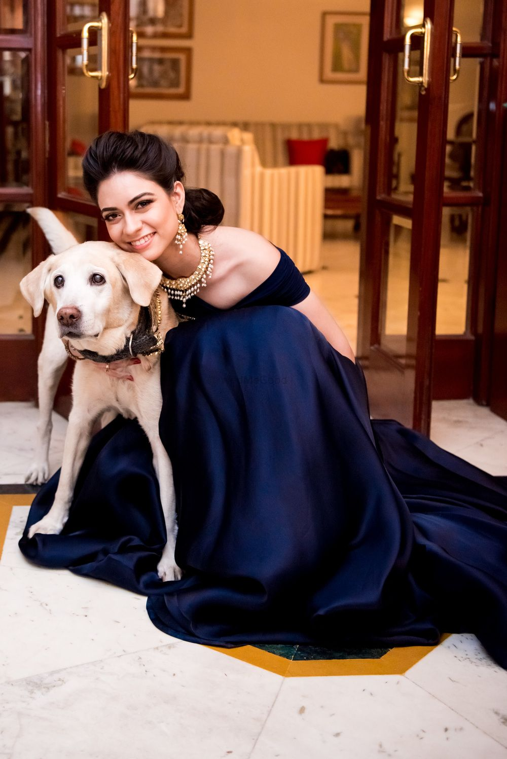 Photo of Bride with pet dog on sangeet