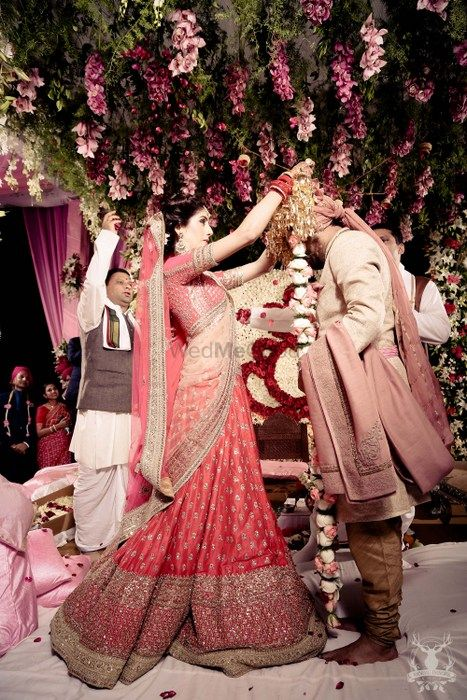 Photo of red bridal lehenga by Sabyasachi with double dupatta