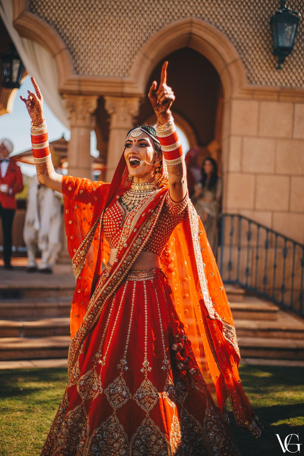 Photo of Bright and happy dancing bride shot on her wedding day