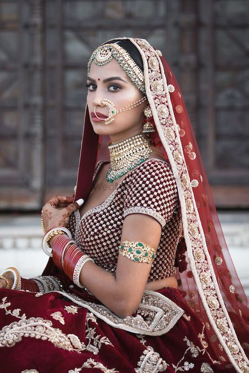 Photo of Sabyasachi bride in maroon lehenga