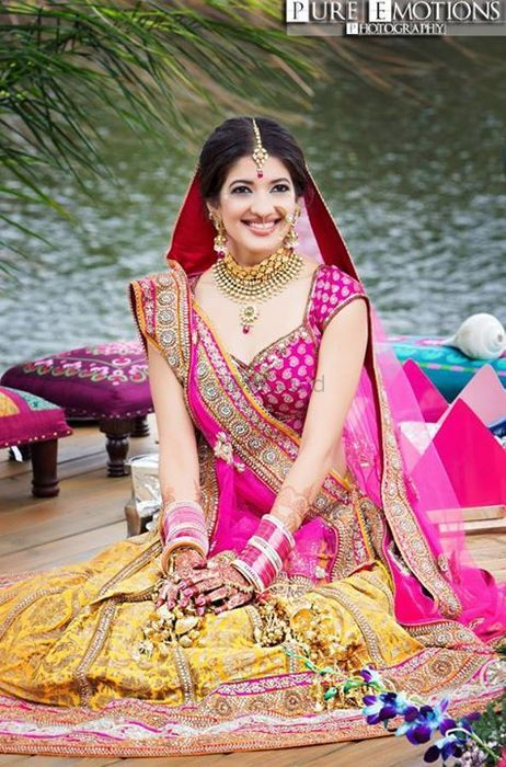 Photo of yellow and pink bridal lehenga