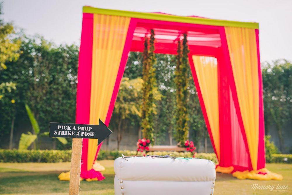 Photo of Orange photobooth backdrop with swing